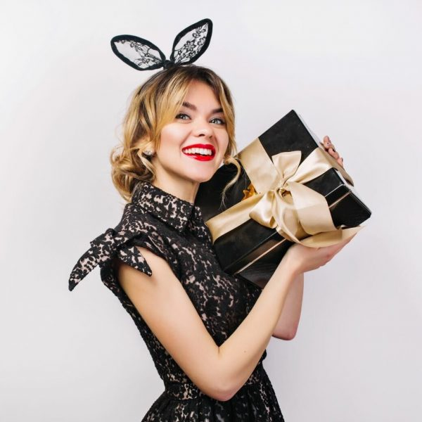 young-stylish-woman-with-gift-box-celebrating-wearing-black-dress-black-crown-happy-birthday-party-having-fun1